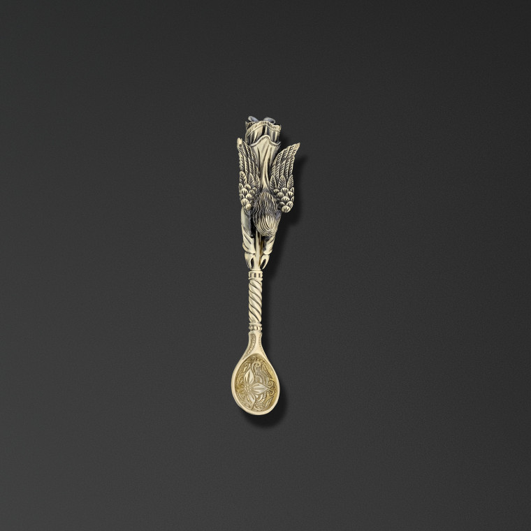 Small spoon with a guardian angel